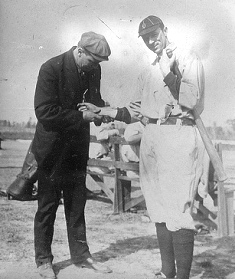 Harry Tuthill, with Tigers pitcher Del Gainer