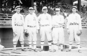 Frank Baker, center, Eddie Collins, far right,
