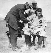 Al Summers has his arm worked on by Tiger trainer Harry Tuthill, first baseman Del Gainer looks on.