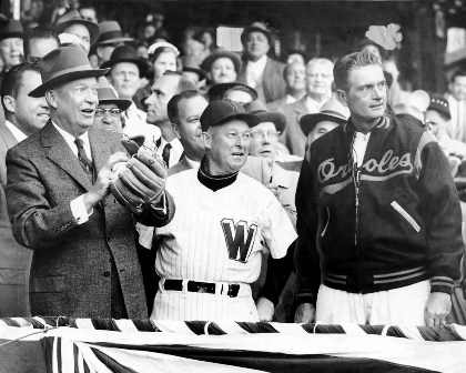 President Eisenhower at the 1957 American League opener in Washington--with Senator  Manager Chuch Dreesen and Baltimore Orioles Manager Paul Richards