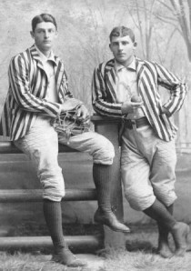 Amos Alonzo Stagg, right, with Yale catcher Jesse Dann