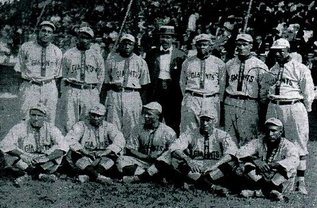 "1910 Chicago Giants--Sitting, left to right, Nate Harris, George ""Chappie"" Johnson, Bill Pettus, ""Smokey"" Joe William, and Dick Wallace, standing, left to right, George Ball, Harry Moore, ""Candy"" Jim Taylor, Frank Leland, Bobby Winston, Joe Green, and Danger Talbert"
