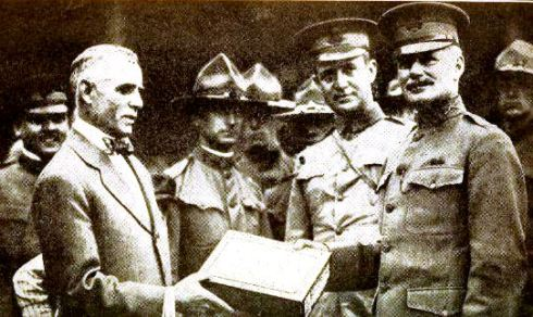Clark Griffith presents a box of baseballs to US Army officers, 1917