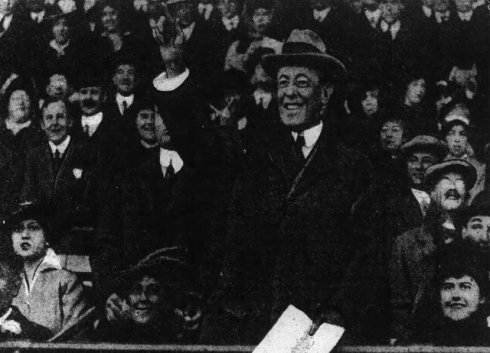 Wilson, program in hand, after throwing first pitch to umpire Billy Evans in 1915.